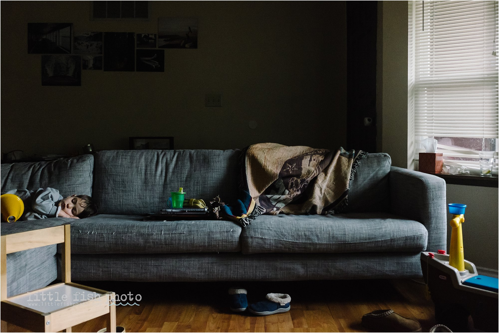 Boy Asleep On Cluttered Couch   Documentary Family Photography